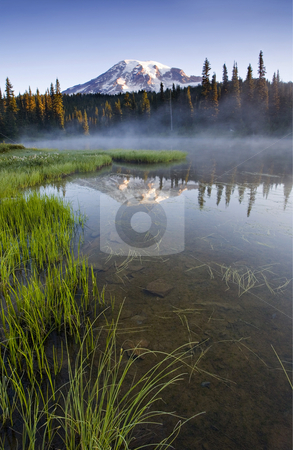 Cold Fog Rising stock photo, Early morning mist rising off an alpine lake as first light hits Mt. Rainier. by Mike Dawson