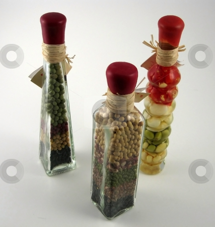 Decorative bottles stock photo, Bottles with oil and legumes inside used for decorative purposes in kitchens by Albert Lozano