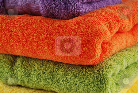 Bath towels stock photo, Stock pictures of colorful bath towels stacked by Albert Lozano