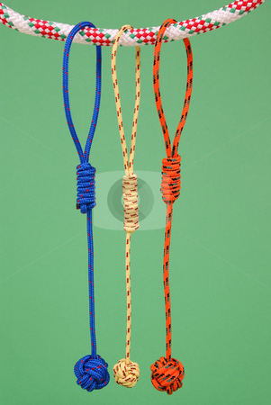 String stock photo, Colorful strings are hanged on another string on green background by Jolanta Dabrowska