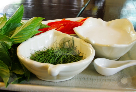 Thai cooking ingredients stock photo, Fresh Thai cooking ingredients; icluding basil, lemongrass and chili by Martin Darley