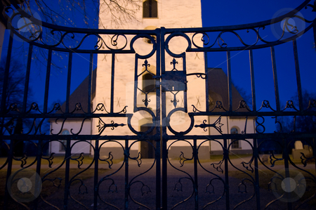 The Gate stock photo, A old iron gate at a entrance to a church and graveyard by Peter Soderstrom
