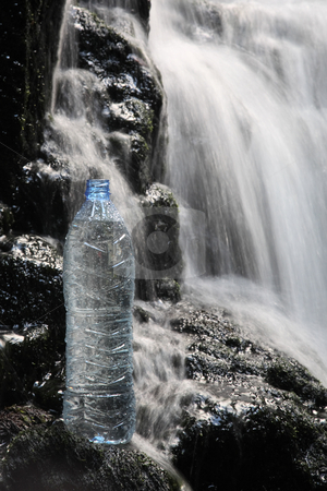 Mineral water in waterfalls stock photo, A bottle of fresh mineral water stands in waterfalls by Laurent Renault