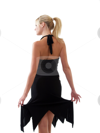 Young blond woman in black skirt from the back stock photo, Young blond woman in black skirt and top from the back by Jeff Cleveland