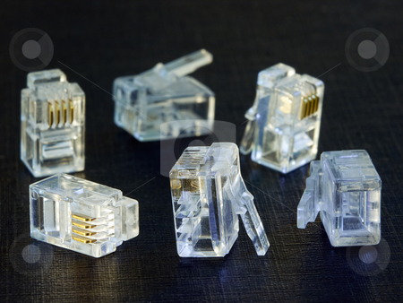 Telephone plugs stock photo, Closeup of several telephone plugs. by Sinisa Botas