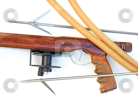 Wooden speargun stock photo, Handmade wooden speargun with an equipment on a clear background. by Sinisa Botas