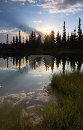 Simple Beauty stock photo, The sun rises over an alpine lake near Mt. Rainier by Mike Dawson