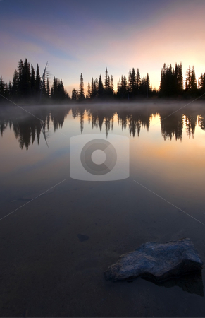Burining Sunrise stock photo, A brilliant dawn reflecting in the still waters of an alpine lake near Mt. Rainier by Mike Dawson