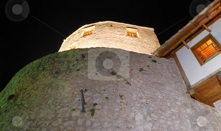 Tower in Mostar Old Town at Night stock photo, View from below at the west tower in Mostar old town at night. by Denis Radovanovic