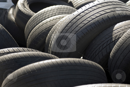 Car tyres stock photo, A pile used car tyres awaiting recycling by Stephen Gibson