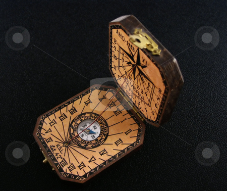 Sun dial stock photo, A pocket, small sun clock, antique by Albert Lozano