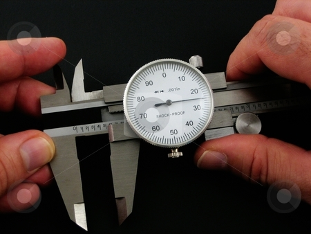 Calipers stock photo, Calipers for measuring very small thickness of machine objects by Albert Lozano