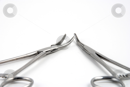 Hemostats and clamps stock photo, Stock pictures of hemostats used in surgical practice by Albert Lozano