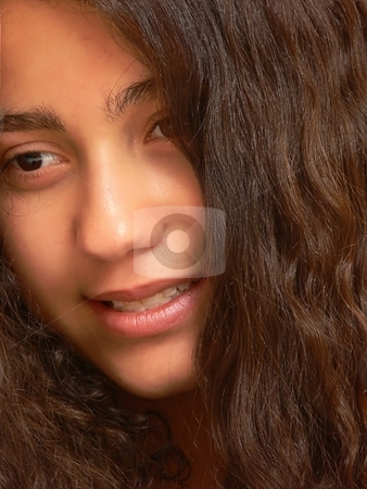 A smiling young girl stock photo, A close-up shot of the face of a pretty young girl with long dark hair for white background an nice smiling. by Horst Petzold