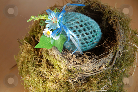 Easter background stock photo, Easter decorative artificial egg in natural bird nest by Julija Sapic