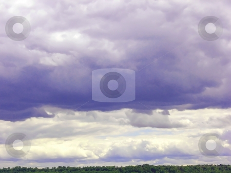 Dark clouds. stock photo, Dark and white clouds on an bright blue sky. by Horst Petzold