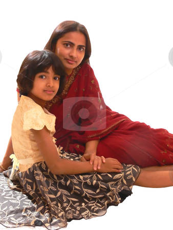 Mother and daughter. stock photo, An Indian mother with her daughter sitting on the floor. The mother in her native red dress. On white background. by Horst Petzold