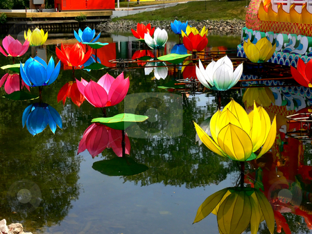 Chinese festival. stock photo, An Chinese festival of the island from Ontario Place in Toronto. Beautiful colorful flowers and there reflection in the water. by Horst Petzold