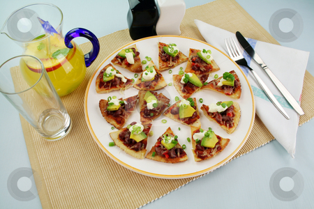 Mexican Triangles stock photo, Delicious mexican triangles with avocado and sour cream with a fruit punch by Brett Mulcahy