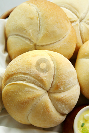 Round Rolls And Butter stock photo, Fresh round breadrolls with a jar of butter and diced spring onions. by Brett Mulcahy