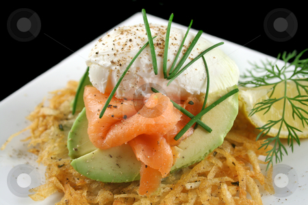 Salmon And Poached Egg Stack  stock photo, Beautiful salmon and poached egg stack on a hash brown with avocado. by Brett Mulcahy