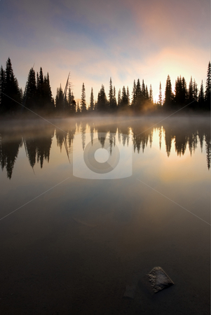 Smoke on the Water stock photo, Mist rises from the still waters of an alpine lake at sunrise. by Mike Dawson