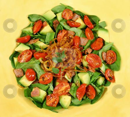 Warm Bacon And Avocado Salad stock photo, Delightful warm baby spinach, avocado and bacon salad with fried onion and oregano . by Brett Mulcahy