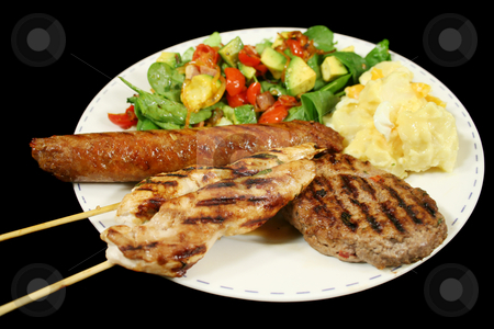 BBQ Lunch stock photo, BBQ chicken tenderloin skewers, beef sausage, beef patty with spinach salad and potato salad. by Brett Mulcahy