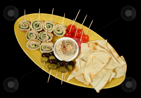 Party Food stock photo, Plate of party food consisiting of olives, pickle onions, pita bread, hummus and ham and cheese roll ups. by Brett Mulcahy