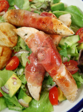 Prosciutto Tenderloins stock photo, Chicken tenderloins wrapped in prosciutto with oven roasted chat potatoes and a garden salad. by Brett Mulcahy