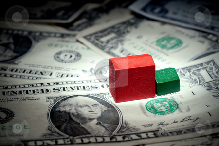 A horizontal view of play houses on dollar bills stock photo, A horizontal view of play houses on dollar bills by Vince Clements