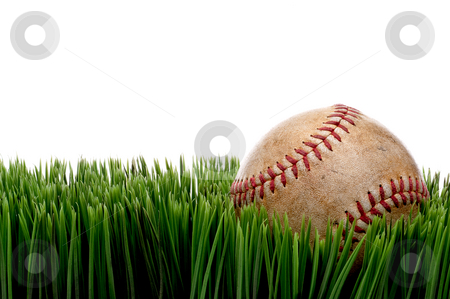 Horizontal view of an old worn sports baseball on grass against  stock photo, Horizontal view of an old worn sports baseball on grass against a white background by Vince Clements