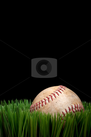 Vertical view of an old worn sports baseball on grass against a  stock photo, Vertical view of an old worn sports baseball on grass against a black background by Vince Clements