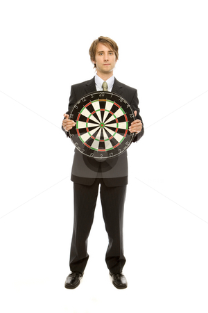 Businessman holds target stock photo, Businessman in a suit stands holding a target by Rick Becker-Leckrone