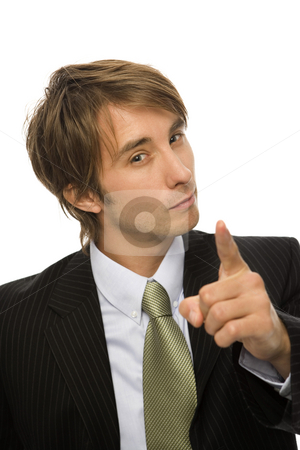 Businessman gestures with finger stock photo, Businessman in a black suit gestures with his finger by Rick Becker-Leckrone