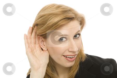 Businesswoman gestures hearing stock photo, Businesswoman gestures as she tries to listen by Rick Becker-Leckrone