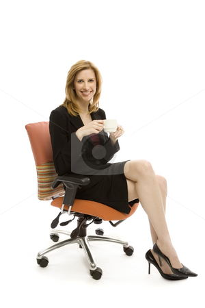 Businesswoman relaxing stock photo, Businesswoman relaxes in a chair with a cup of coffee by Rick Becker-Leckrone