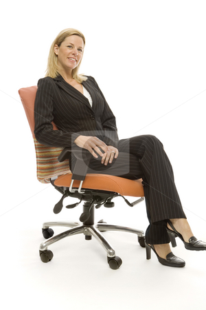 Businesswoman sits relaxing stock photo, Businesswoman in a suit sits relaxing in a chair by Rick Becker-Leckrone