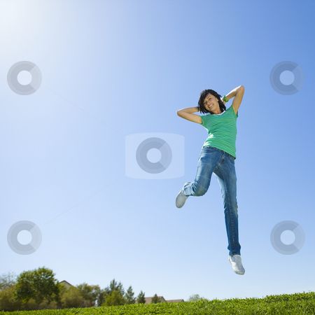 Happy teen jumps in air stock photo, Happy teen jumps in air by Rick Becker-Leckrone