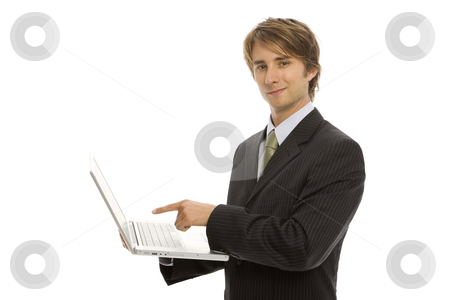 Businessman points to laptop stock photo, Businessman holds a laptop and points to the screen by Rick Becker-Leckrone