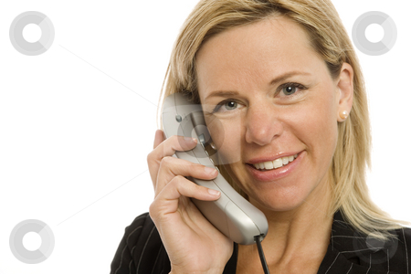 Businesswoman uses phone stock photo, Businesswoman in a suit uses a corded telephone by Rick Becker-Leckrone