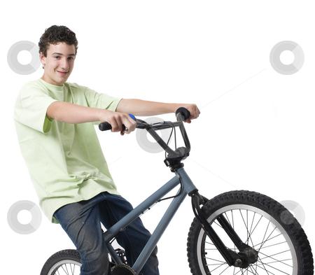 Boy rides bike stock photo, A boy rides his bike and smiles by Rick Becker-Leckrone