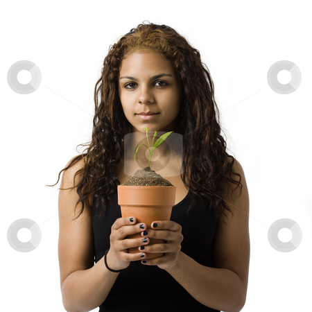 Girl holds potted plat stock photo, Agirl holds a potted plant by Rick Becker-Leckrone