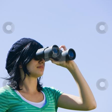 Teen with binoculars stock photo, A teenager looks through binoculars by Rick Becker-Leckrone