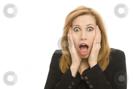 Businesswoman gestures surprise stock photo, A businesswoman in a suit gestures surprise by Rick Becker-Leckrone