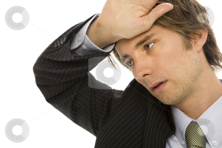 Businessman with stress stock photo, Businessman holds his hand to his head in stress by Rick Becker-Leckrone