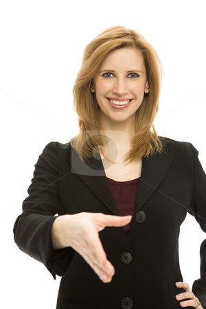 Businesswoman handshake stock photo, Businesswoman in a suit gestures a handshake against a white background by Rick Becker-Leckrone