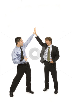 Businessmen give a high five stock photo, Two businessmen give each other a high five by Rick Becker-Leckrone
