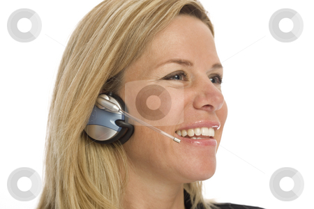 Woman with headset stock photo, Woman with headset smiles against a white background by Rick Becker-Leckrone