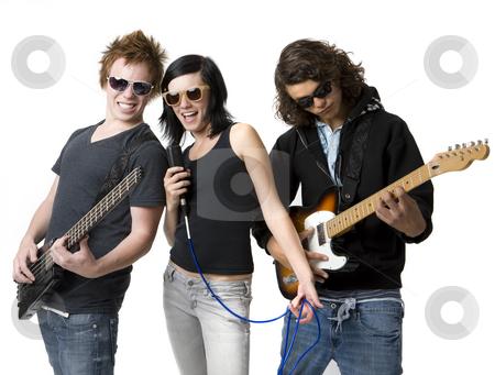 Three bandmates rock out stock photo, Three bandmates sing and play guitar by Rick Becker-Leckrone